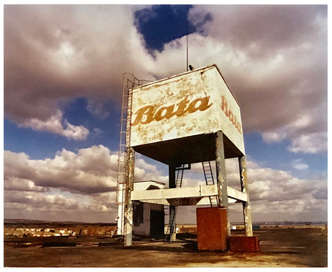 Bata Water Tower in Thurrock with moody clouds in the sky photograph.