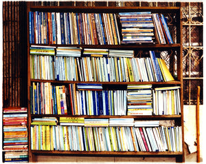 street photography of multi-color books in a book case