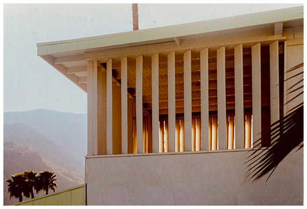 Captured by Richard Heeps for his 'Dream in Colour' series, this piece features the mid-century architecture of Ballantines Movie Colony, California, captured at dusk against the Palm Springs mountainous landscape.