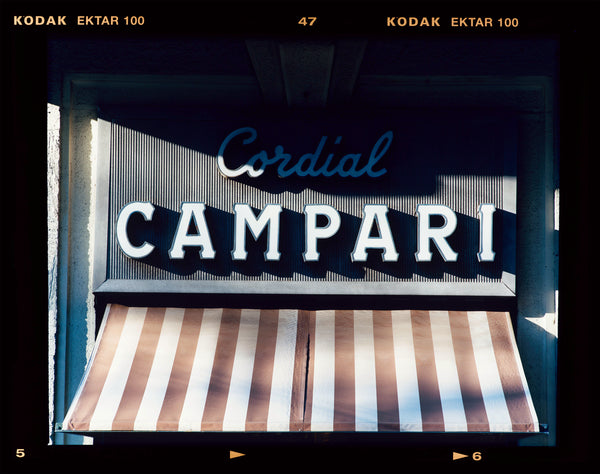Cordial Campari, photographed as part of Richard Heeps' series 'A Short History of Milan' features typography above the striped awning of a fascist building.