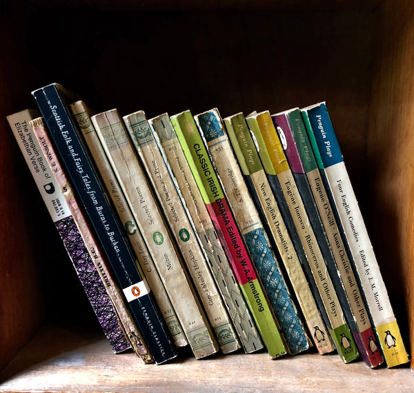 Folk and Fairy Tales, Wells-next-the-Sea shows the well worn spines of vintage books on a shelf, photographed by Richard Heeps in a secondhand bookshop in the British seaside town Wells-next-the-Sea.
