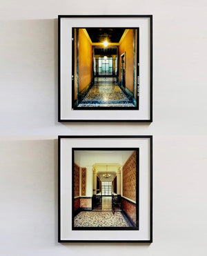 An Art Deco entrance hall in Milan, featuring stained glass panelling and marble flooring.