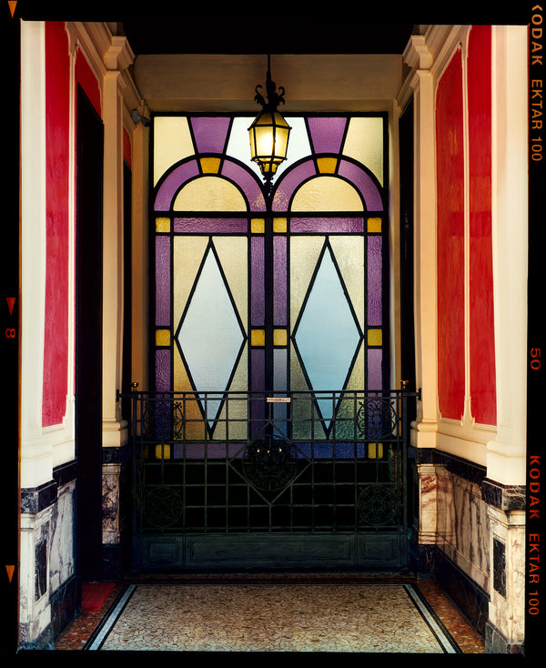 'Foyer VII' shows an Art Deco entrance hall in Milan, featuring stained glass panelling and marble flooring. This piece is part of Richard Heeps' series 'A Short History of Milan', which began in November 2018 for a special project featuring at the Affordable Art Fair Milan 2019, and the series is ongoing. There is a reoccurring linear, structural theme throughout the series, capturing the Milanese use of materials in design such as glass, metal, wood and stone.