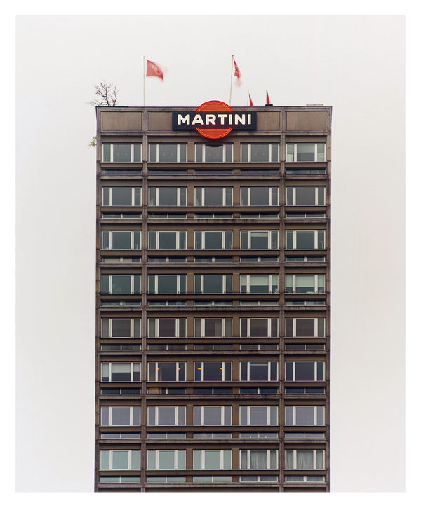 Central Milan's rooftop bar 'Terazza Martini', is the subject of Richard Heeps' 'Grey Martini'. This piece is part of his series 'A Short History of Milan' which began in November 2018 for a special project featuring at the Affordable Art Fair Milan 2019, and the series is ongoing. There is a reoccurring linear, structural theme throughout the series, capturing the Milanese use of materials in design such as glass, metal, wood and stone.