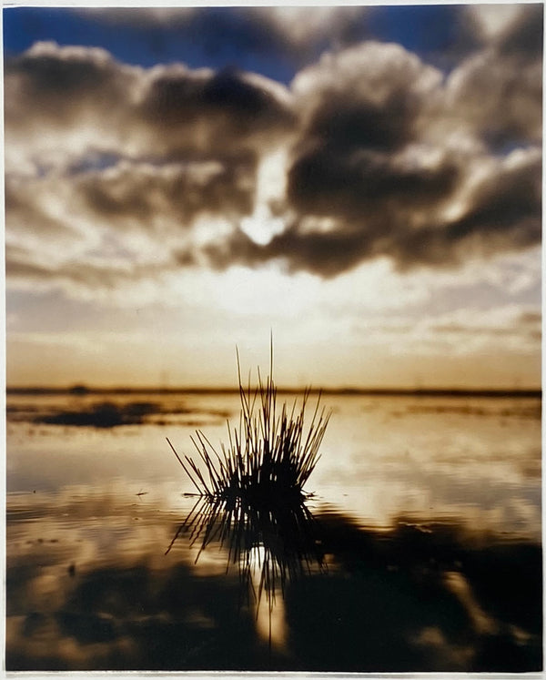 Landscape photography from the fenlands with a cloudy sky reflecting in water.