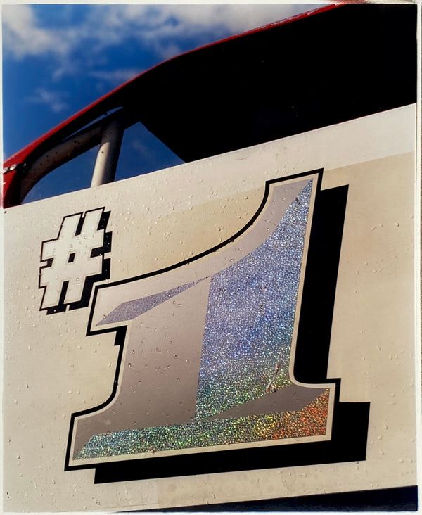 Number one on the side of a race car.