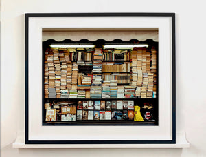 Books photographed under fluorescent lighting as part of Richard Heeps' series A Short History of Milan.