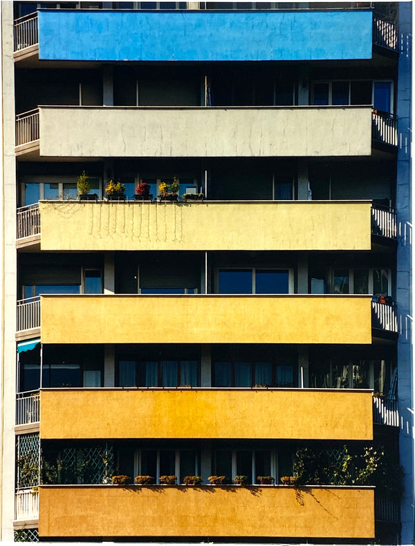 Rainbow Apartments shows a multi-coloured nineteen-sixties block of flats. From Richard Heeps' photography series 'A Short History of Milan', capturing Italian design and architecture.