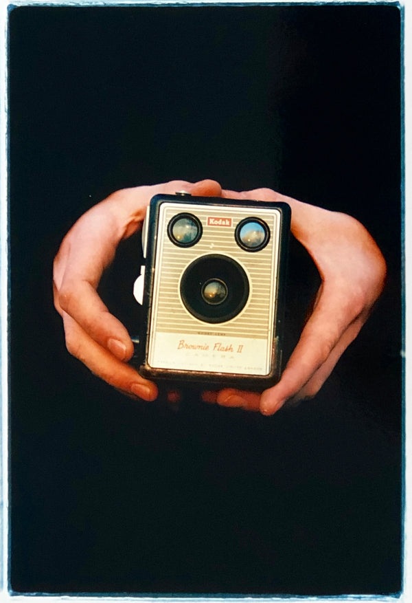 A vintage Kodak Box Brownie camera held by artist Richard Heeps