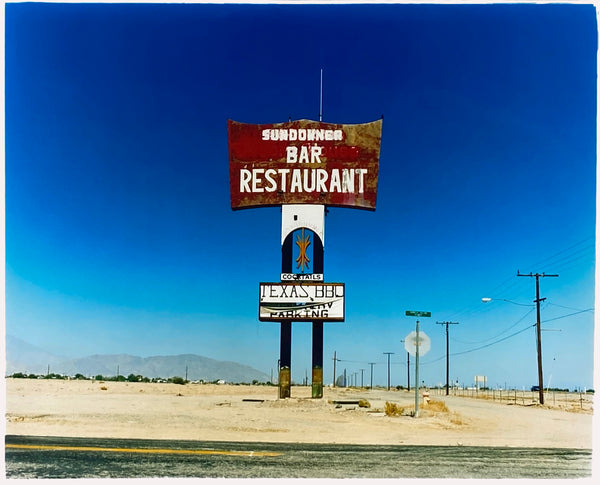 This isolated giant great roadside sign set against a vast blue sky is a remnant of The Sundowner Bar and Restaurant of the Motel which is unfortunately no more. This photograph, part of Richard Heeps Salton Sea Series captures the landscape of the western side of the lake.