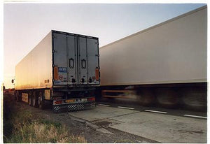 A set of photographs that followed a straight line. The images would go through, over and under what ever came in the path of the camera's lens: truck, lorry, heavy goods vehicle.