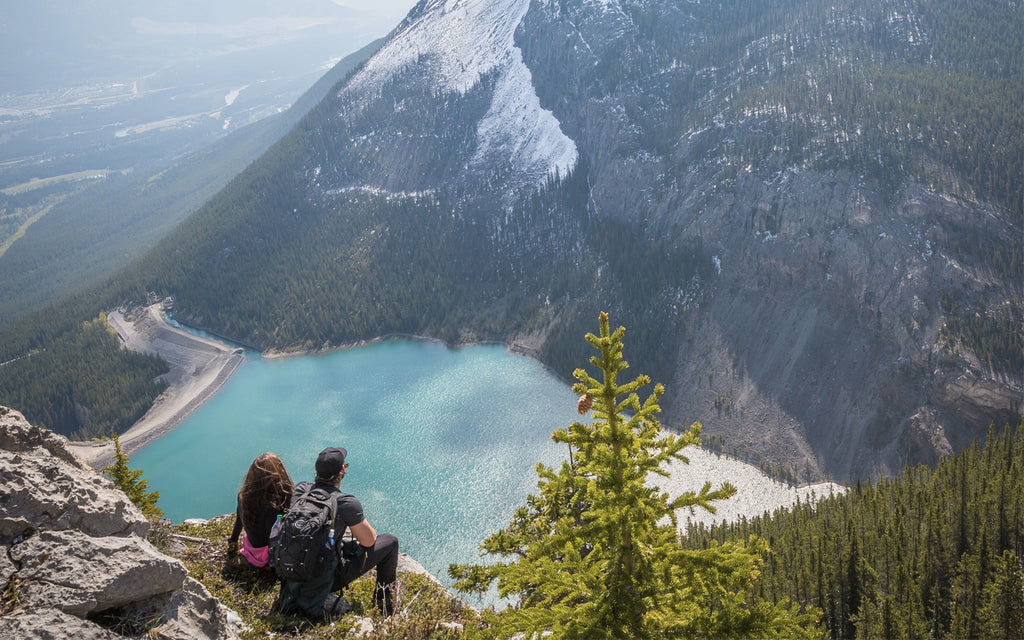 man woman hiking mountain lake nature beautiful