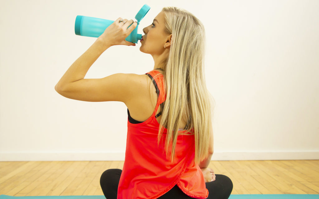 young woman drinking water hidratespark 3 scuba teal yoga workout