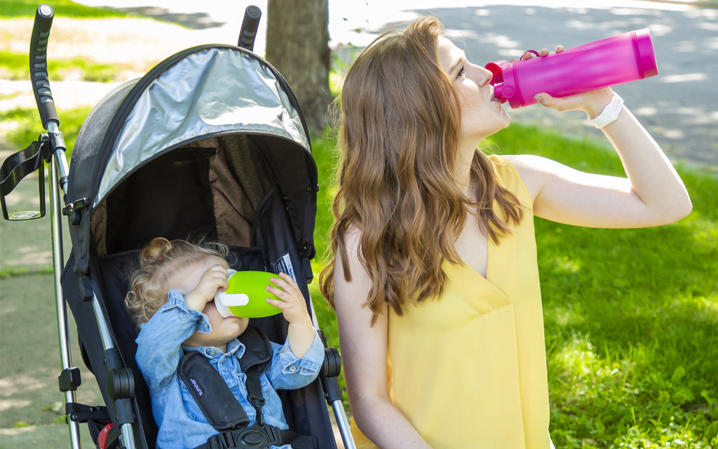 young woman baby stroller drink water berry hidratespark 3 smart water bottle pink