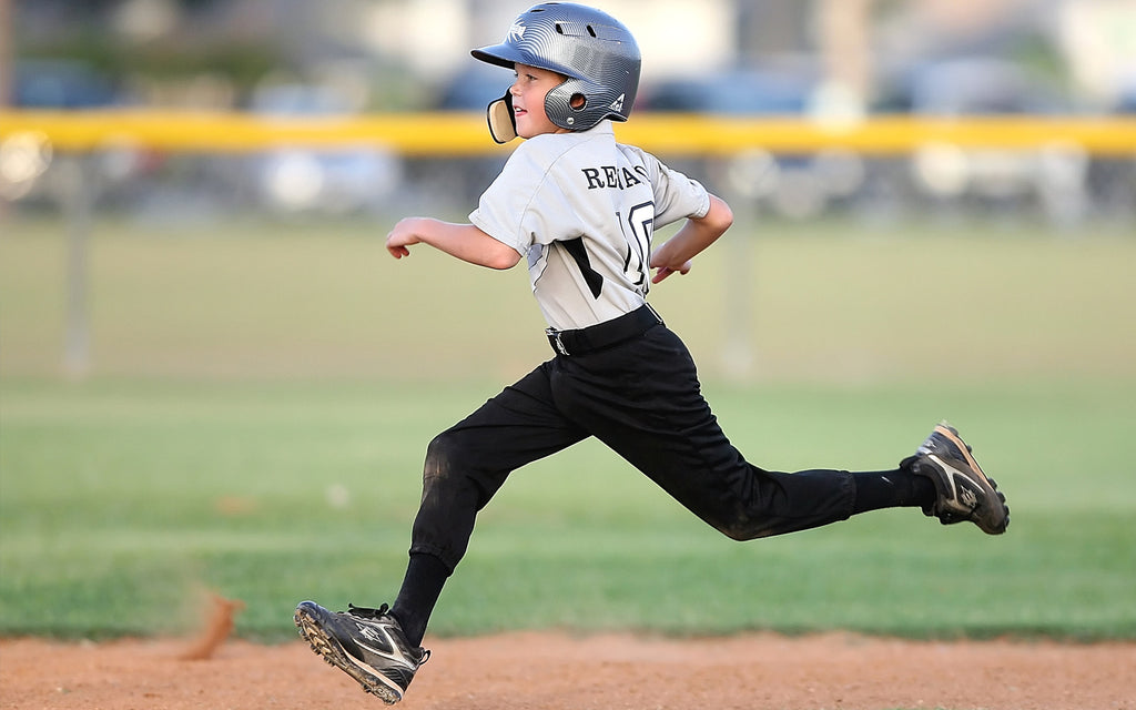 boy child running baseball