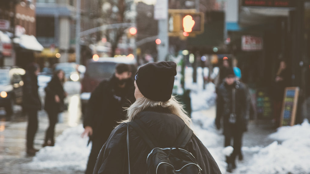 women walking the winter city streets discovering what's around her