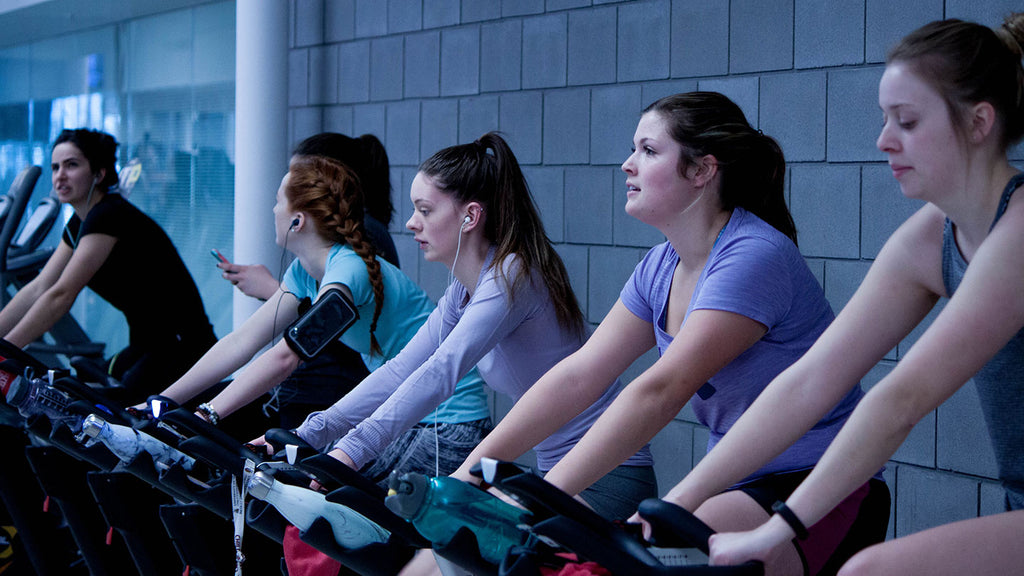 group workout class using elliptical fitness bikes