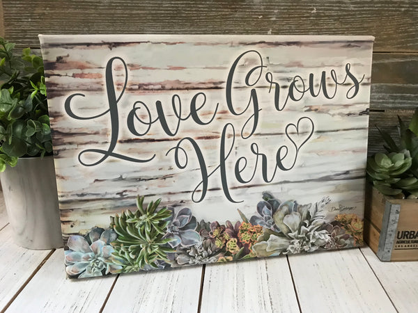 Love Grows Here Canvas Wall Art