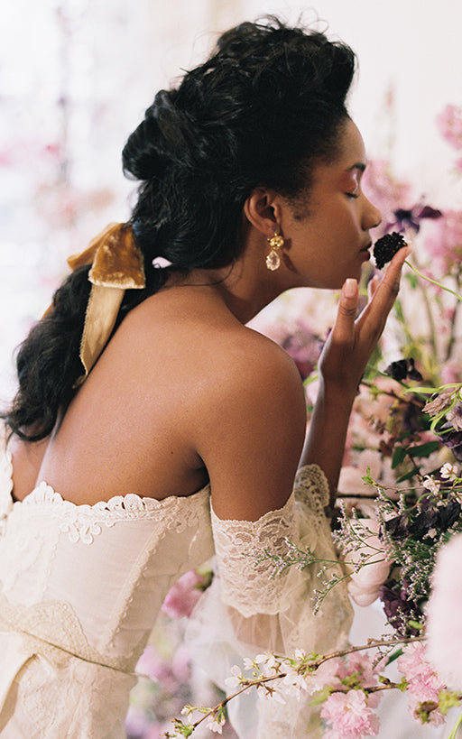 Model wearing Marie Bridal Gown by Claire Pettibone