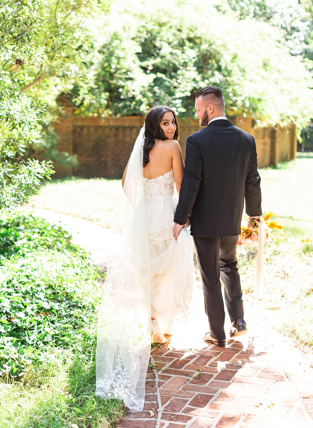 Bride in Lace Wedding Dress and Groom in Blace Tuxedo