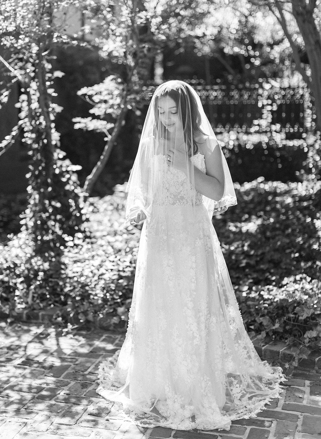 Bride in Lace Wedding Dress by Claire Pettibone