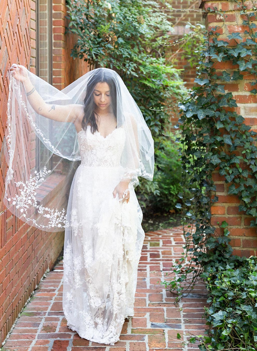 Bride in Lace Wedding Dress and Bridal Veil