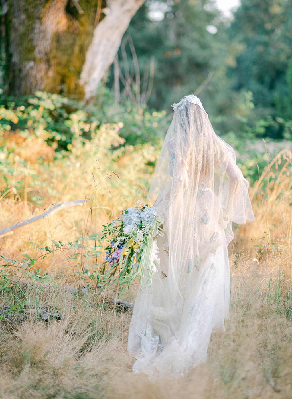 Bride in Wedding Dress and Veil in Garden Wedding Setting