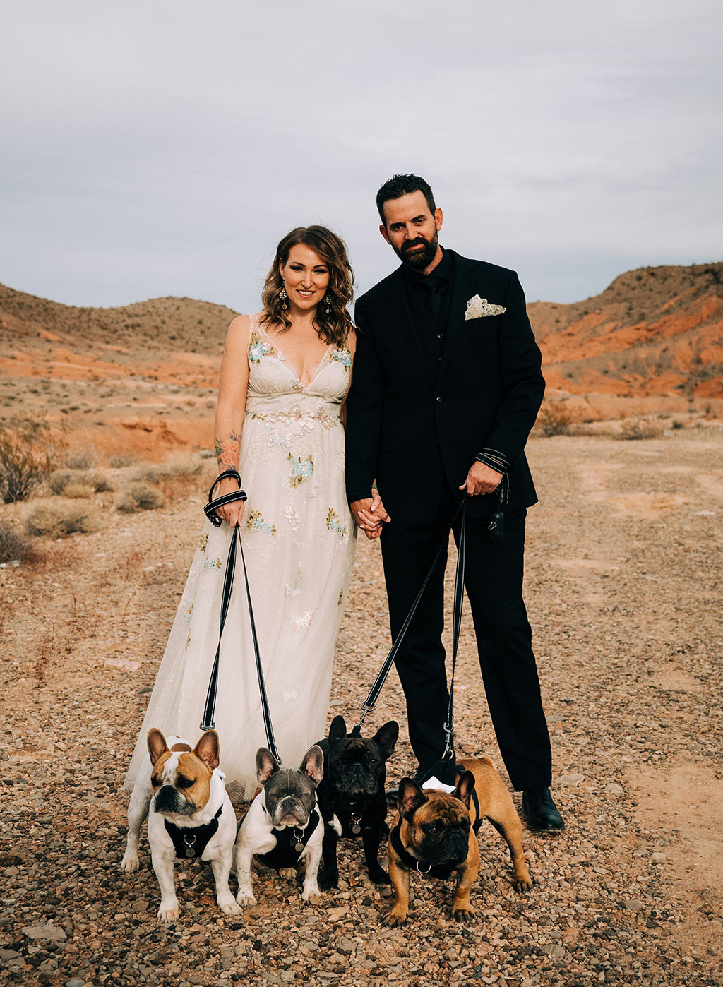 Bride and Groom with dogs in Desert wedding setting