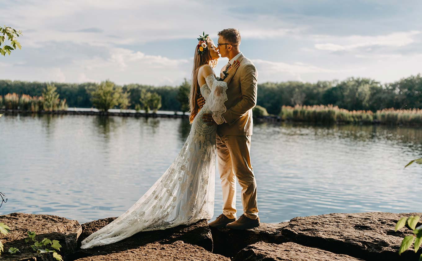 Bride and Groom Kissing by lakeside