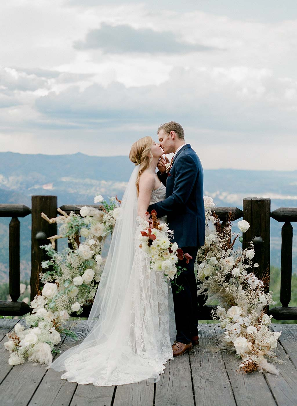 Bridal Couple with Wedding Floral Display