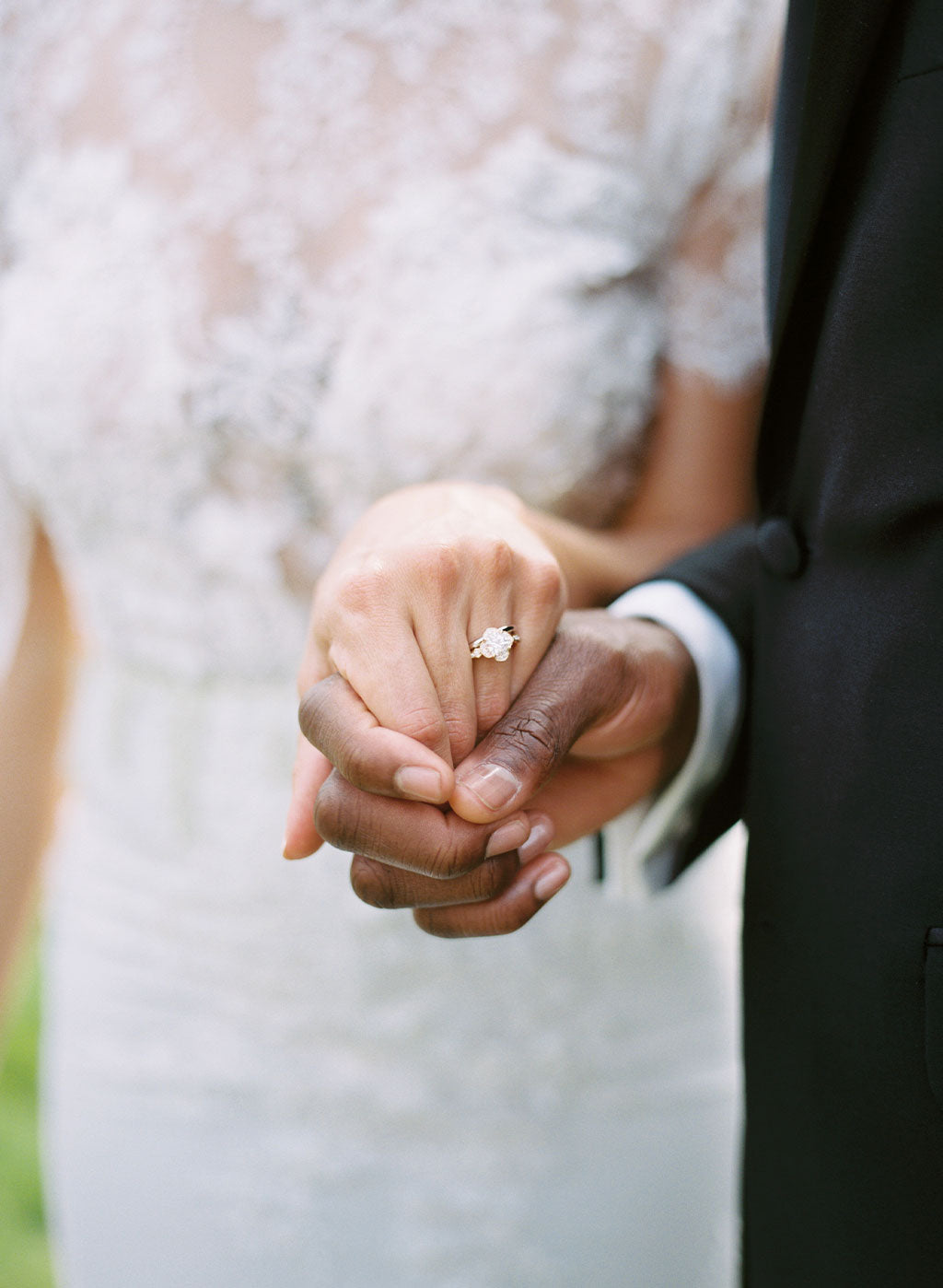 Wedding couple holding hands wedding ring shown