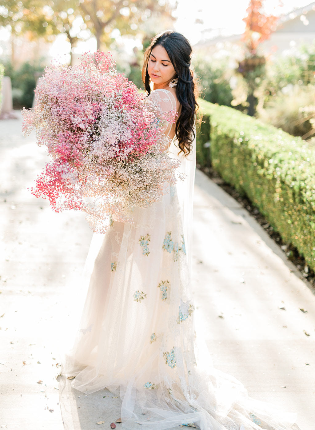 Bride Holding Wedding Floral Arrangement