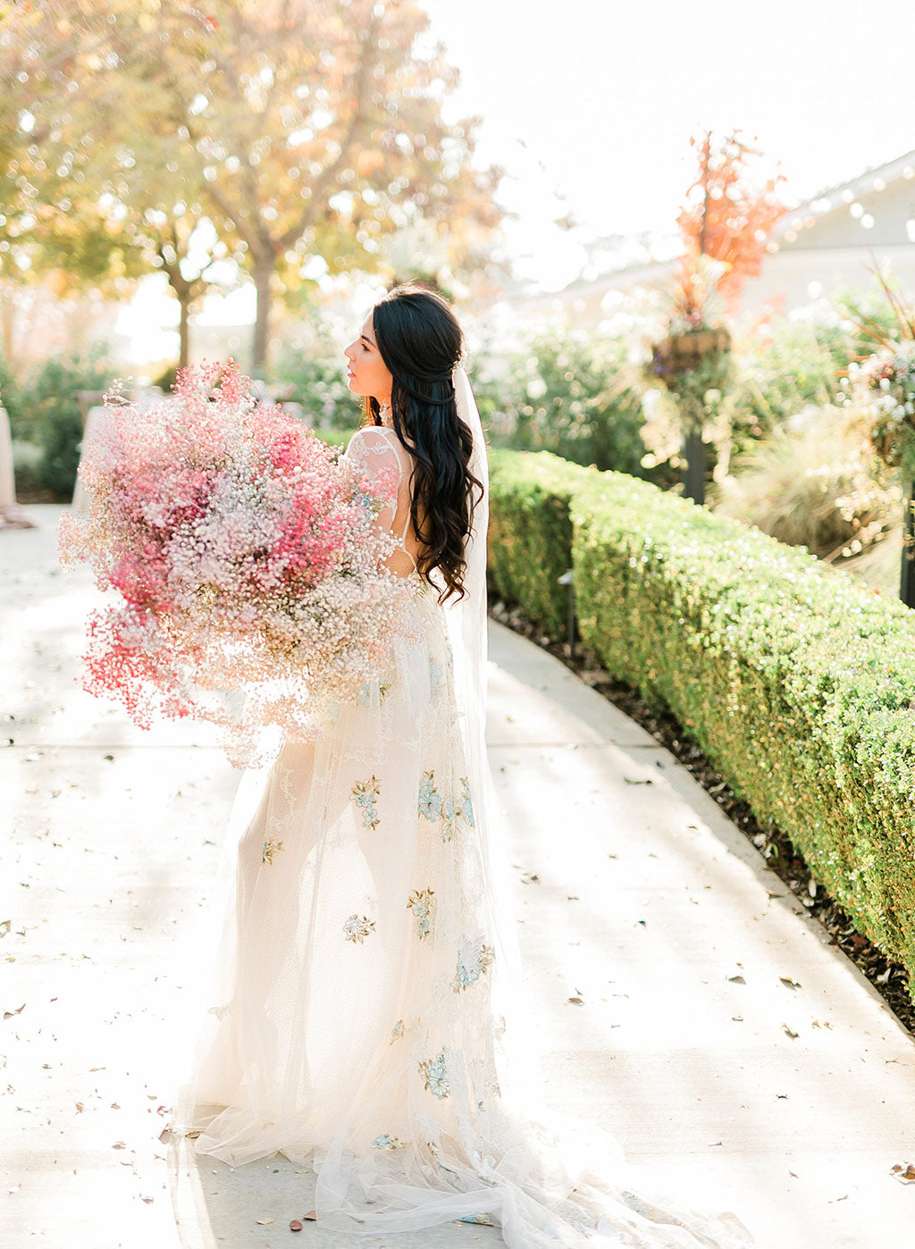 Bride in Chrysalis Wedding Dress by Claire Pettibone