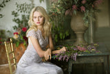 Cora - Couture Wedding Dress by Claire Pettibone campaign image seated close