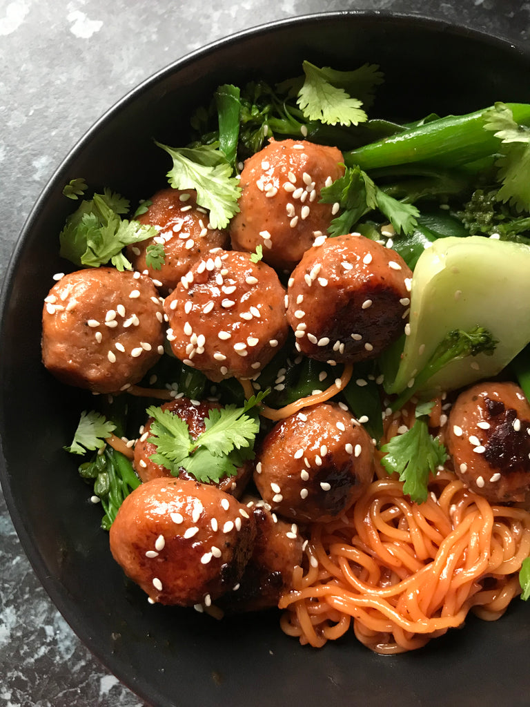 Sticky BBQ meatballs with Asian Greens