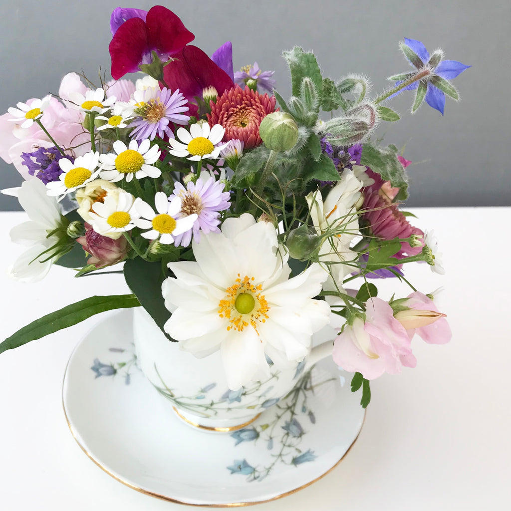 Learn How To Create A Cup of Flowers Arrangement