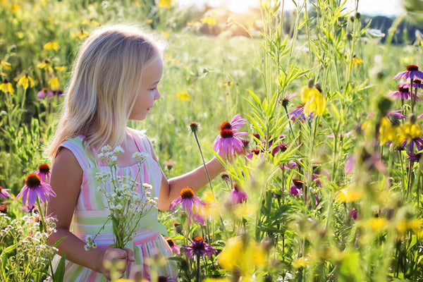 Girl Picking Flowers For Children's Flower Party