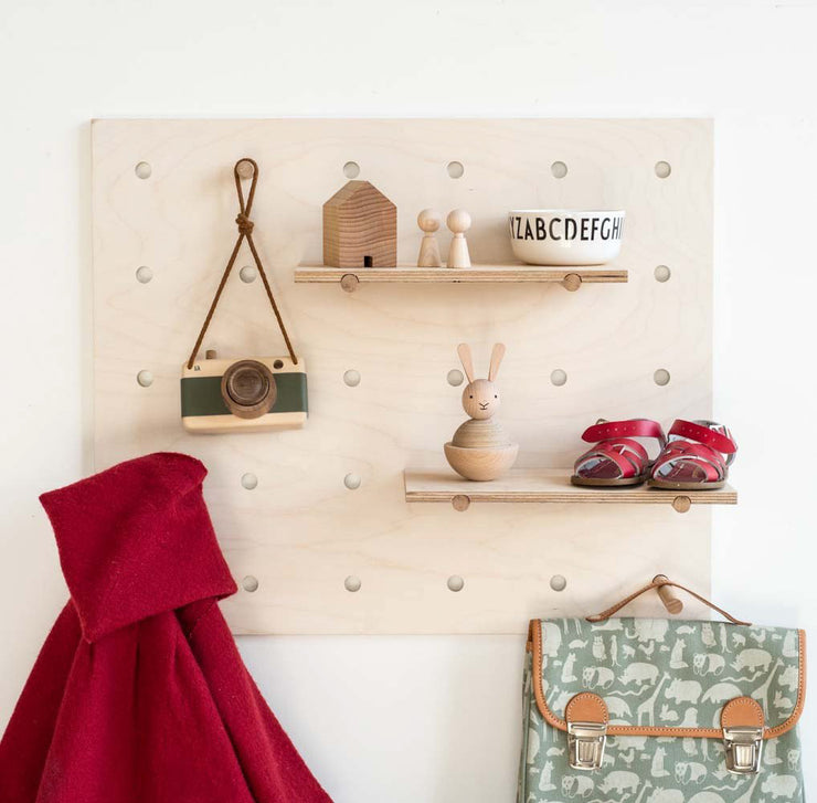 peggy peg board is a modern storage solution for tiny homes and loft living