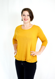Three-quarter length sleeve breastfeeding shirt in trendy mustard color. Made with a buttery-soft viscose blend. Designed in the US.