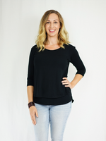 Three-quarter length sleeve breastfeeding shirt in black to go with everything and hiding nursing stains. Made with a buttery-soft viscose blend. Designed in the US.