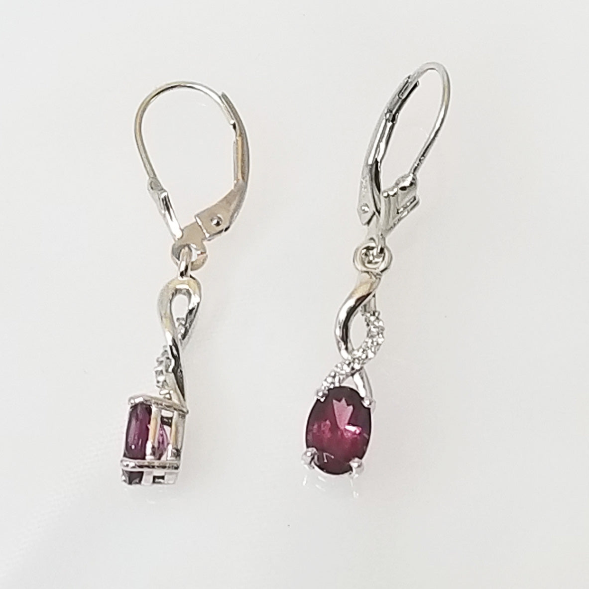 Ready to ship rhodolite garnet and diamond dangle earrings in 14k white gold