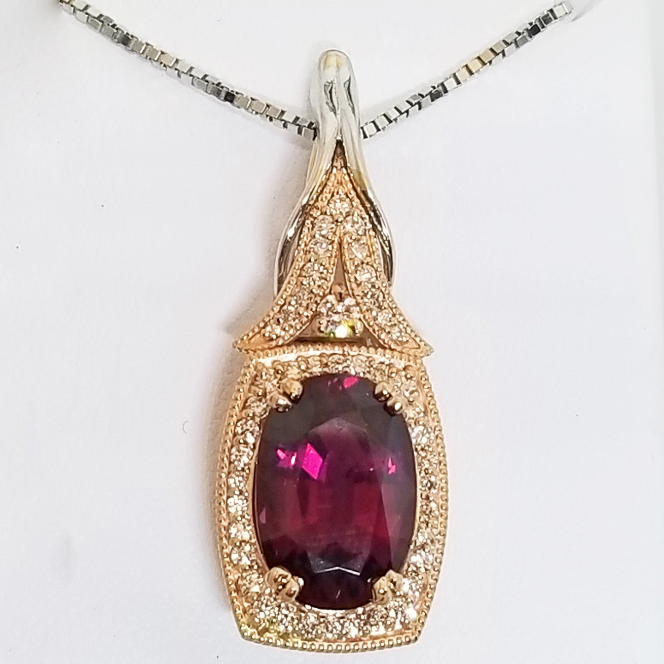Ready to ship rhodolite garnet and diamond pendant in 14k rose and white gold