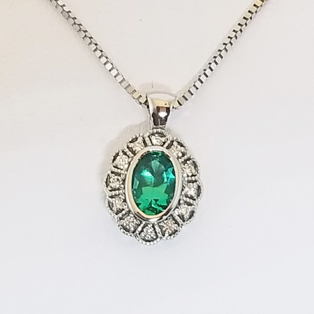 Ready to ship helenite and diamond bezel pendant in 14k white gold