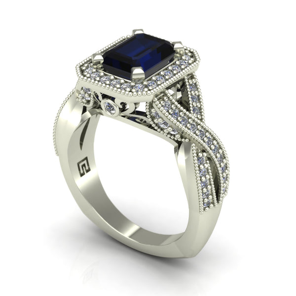 Blue sapphire and diamond emerald cut ring with halo and crossover shank in 14k white gold