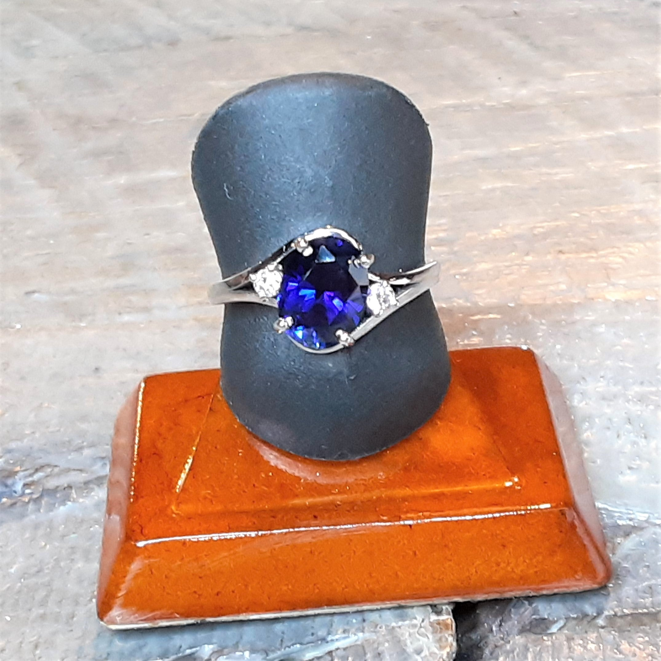 Ready to ship lab created blue sapphire and diamond bypass ring in 14k white gold