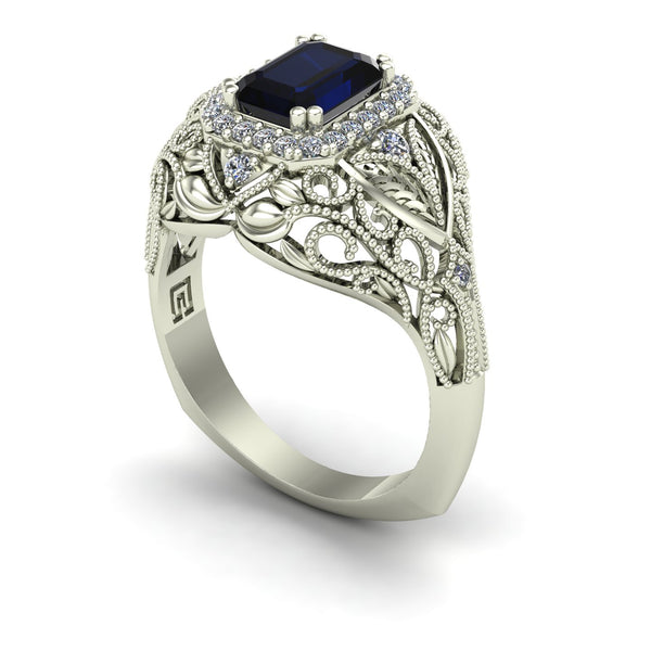 Blue sapphire and diamond emerald cut ring in 14k white gold