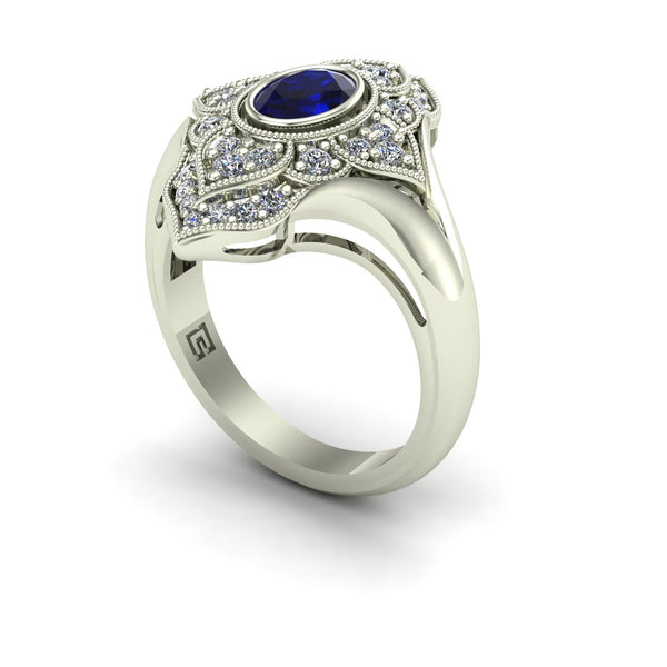 Blue sapphire and diamond paneled dinner ring in 14k white gold