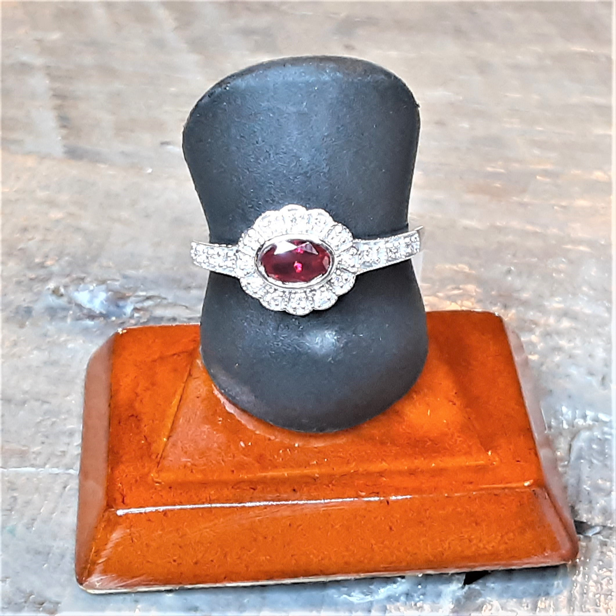 Ready to ship lab ruby and diamond halo ring in 14k white gold