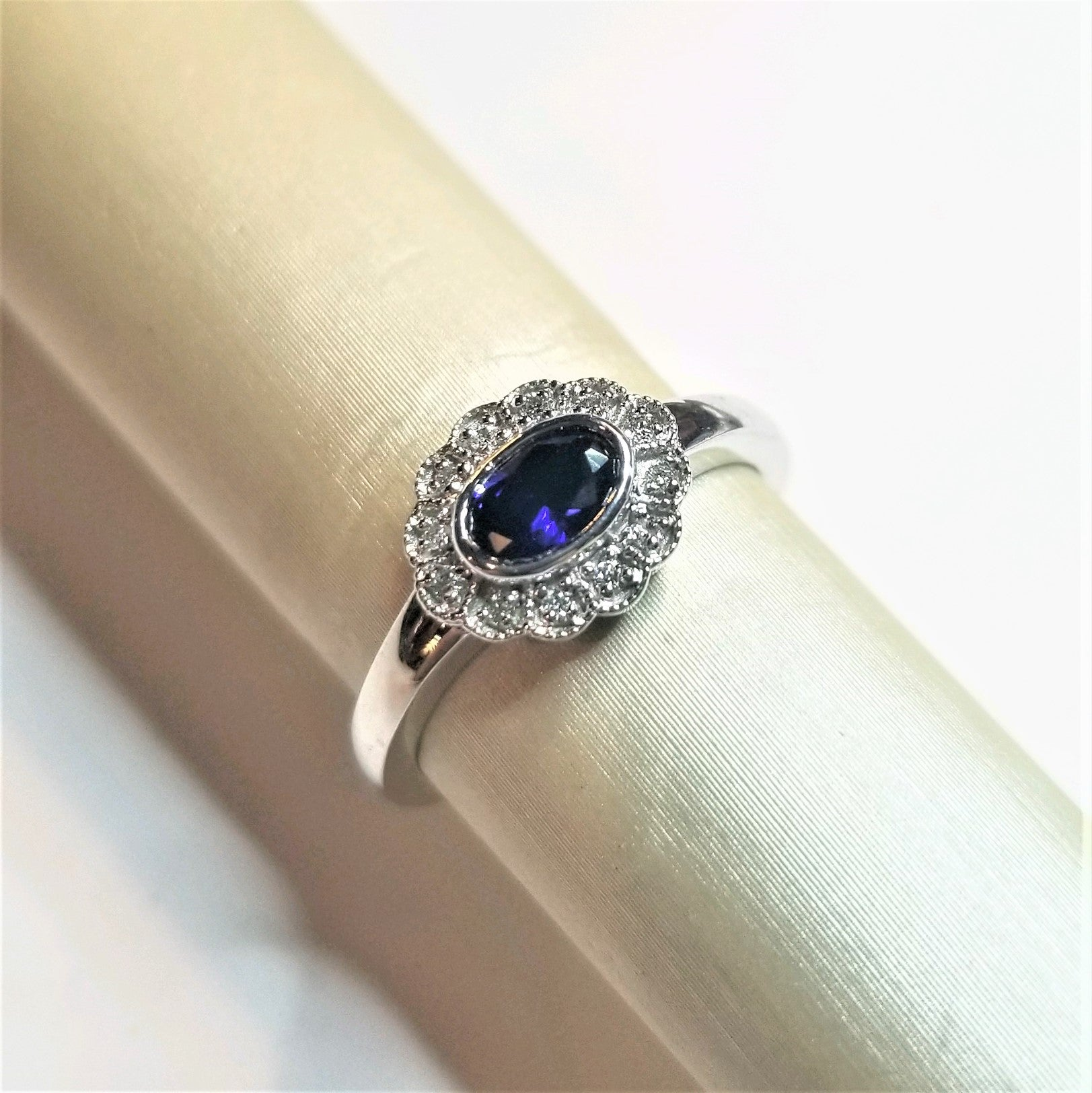 Ready to ship lab Blue sapphire and diamond halo ring in 14k white gold