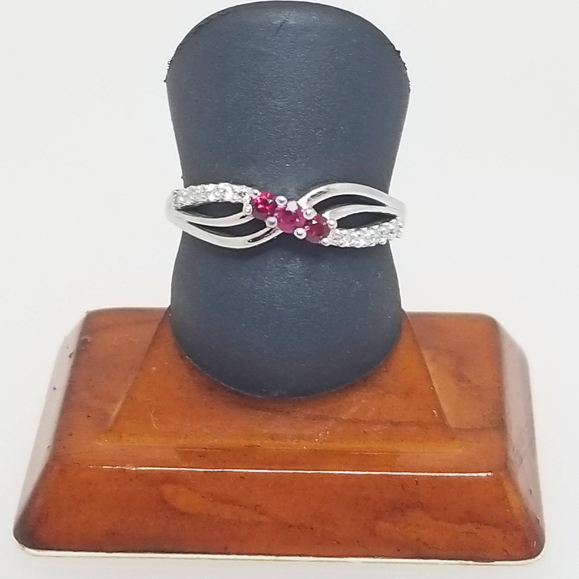 Ready to ship ruby and diamond three stone ring in 14k white gold